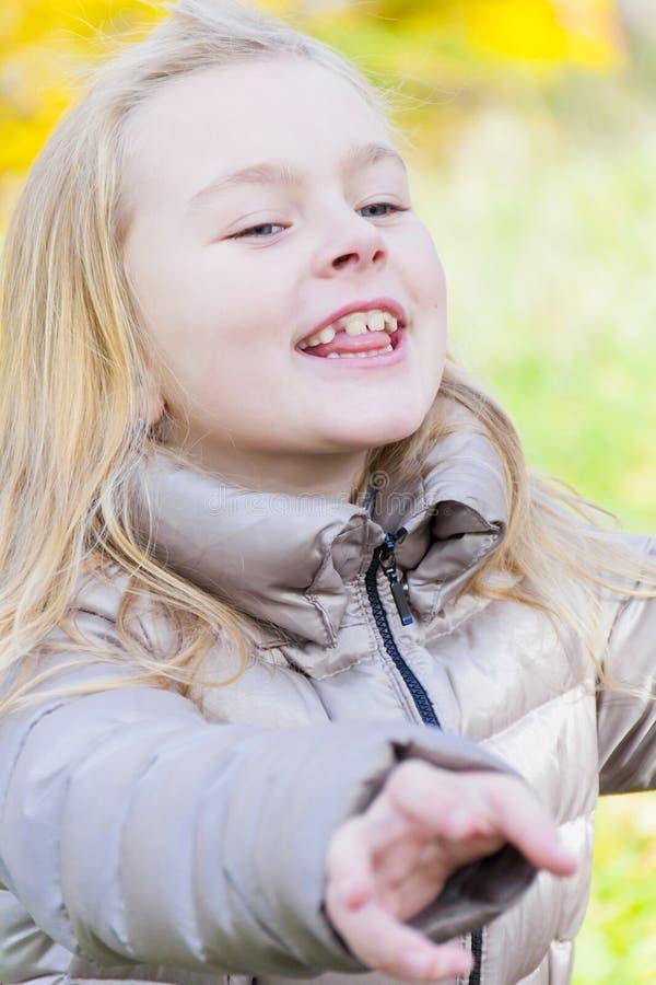 Cute laugh girl in sunlight. Autumn portrait of laugh girl in sunlight stock photography