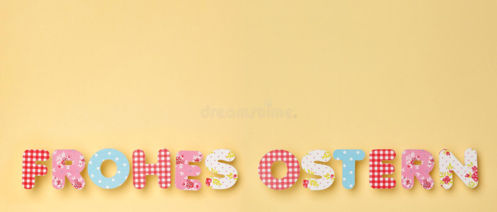 Cute Letters on Yellow - German: Frohes Ostern: Happy Easter, wi royalty free stock photography