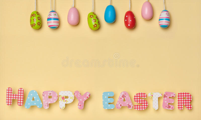 Cute Letters on Yellow - Happy Easter, with little colorful east stock photo