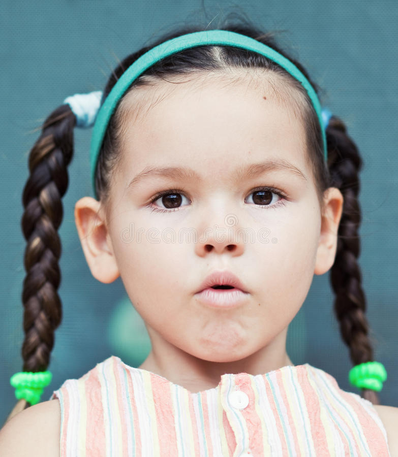 Cute little аsian girl with pigtails royalty free stock photo