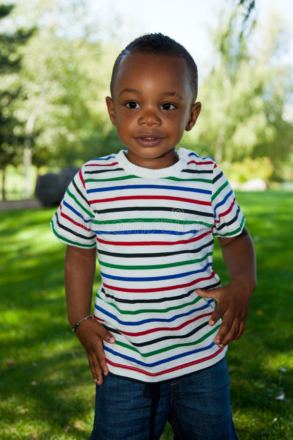 Cute Little african american baby boy playing stock photo