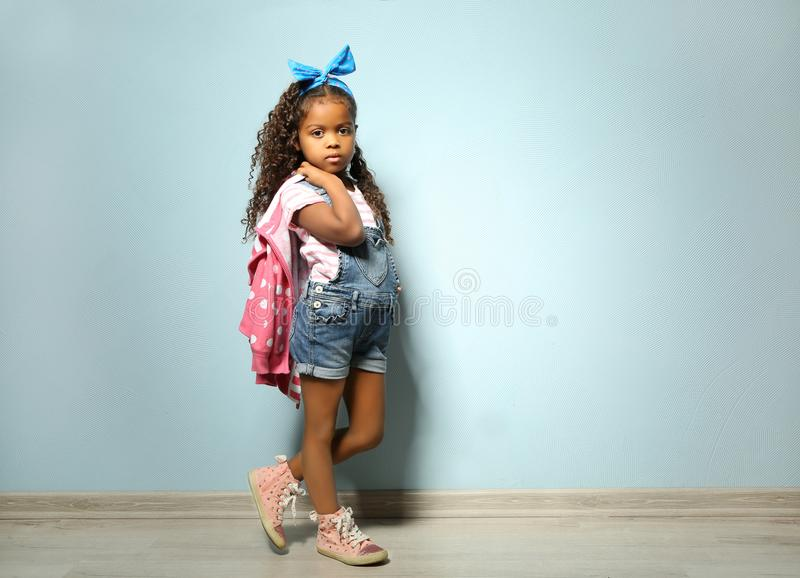 Cute little African American girl in denim royalty free stock images