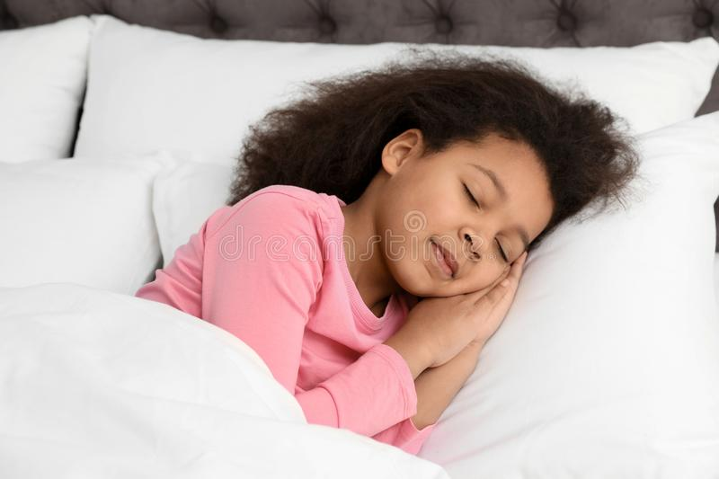 Cute little African-American girl sleeping royalty free stock photography