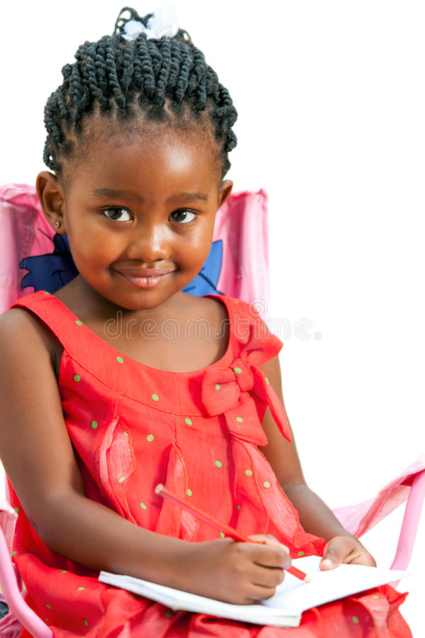 Cute little african girl drawing. royalty free stock photos