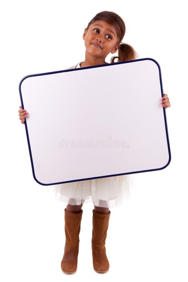 Cute little african girl holding a whiteboard stock photos
