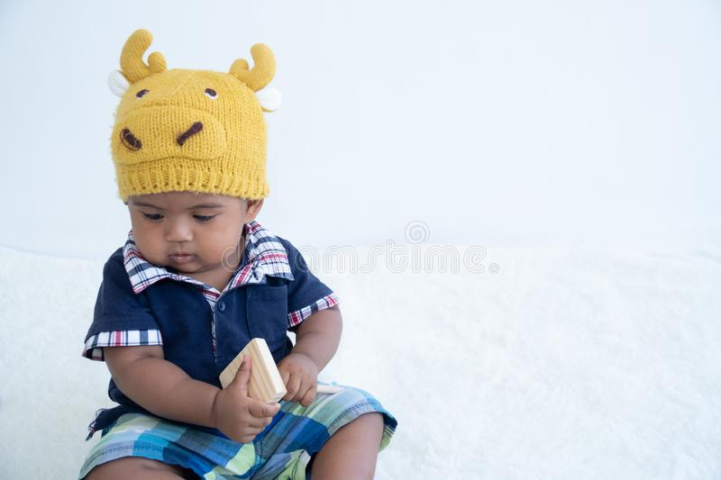 Cute little asian baby boy sitting and play toy royalty free stock photography