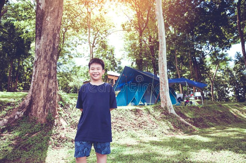 Cute little asian boy under big tree outdoor in the park royalty free stock images
