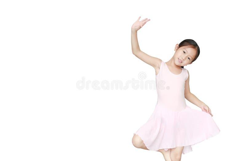 Cute little Asian child girl ballerina in pink tutu skirt isolated on white background. Kid practise her dance. Children ballet royalty free stock photos