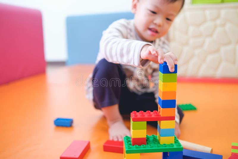 toddler boy child having fun playing with colorful plastic blocks indoor stock images