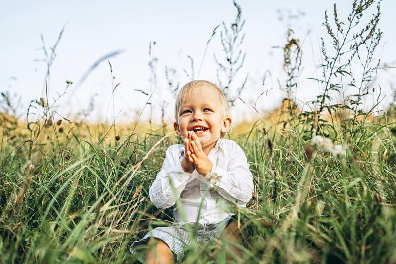 Pretty little baby boy have fun outdoor royalty free stock photo