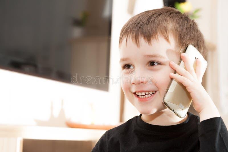 Cute little baby boy is talking stock image