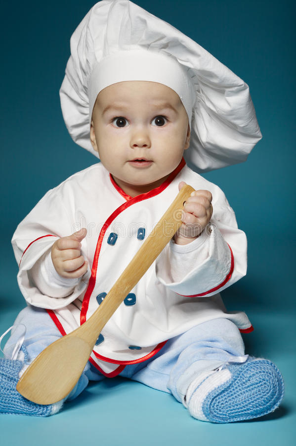 Cute little baby with chef hat royalty free stock photo