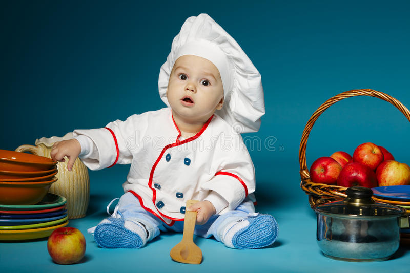 Cute little baby with chef hat stock images