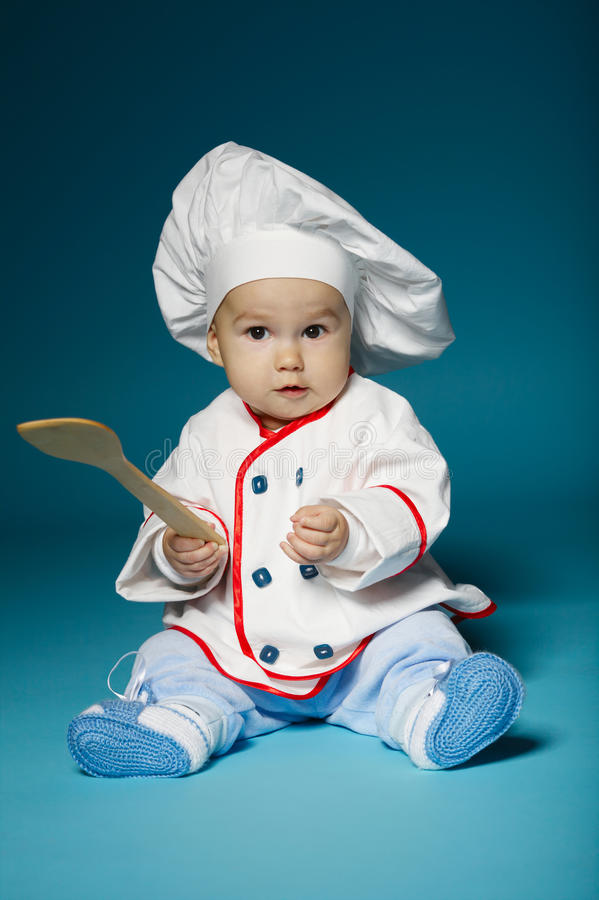 Cute little baby with chef hat stock photos