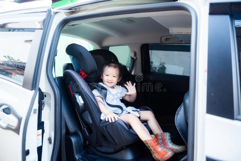 Cute little baby child sitting in car seat. Child transportation safety. Portrait of cute little baby child sitting in car seat. Child transportation safety royalty free stock photos