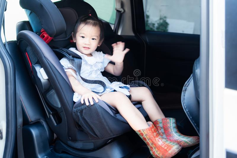 Cute little baby child sitting in car seat. Child transportation safety. Portrait of cute little baby child sitting in car seat. Child transportation safety royalty free stock photography