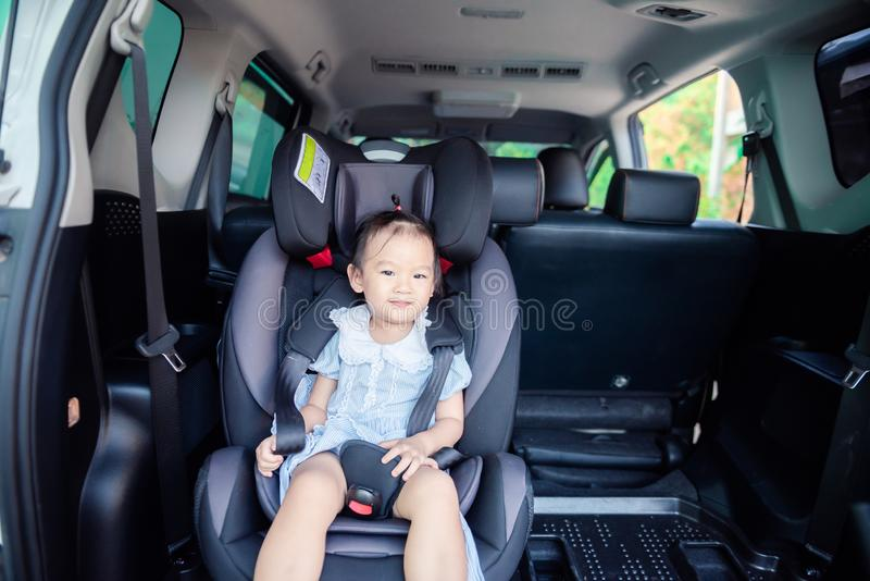Cute little baby child sitting in car seat. Child transportation safety. Portrait of cute little baby child sitting in car seat. Child transportation safety royalty free stock photo