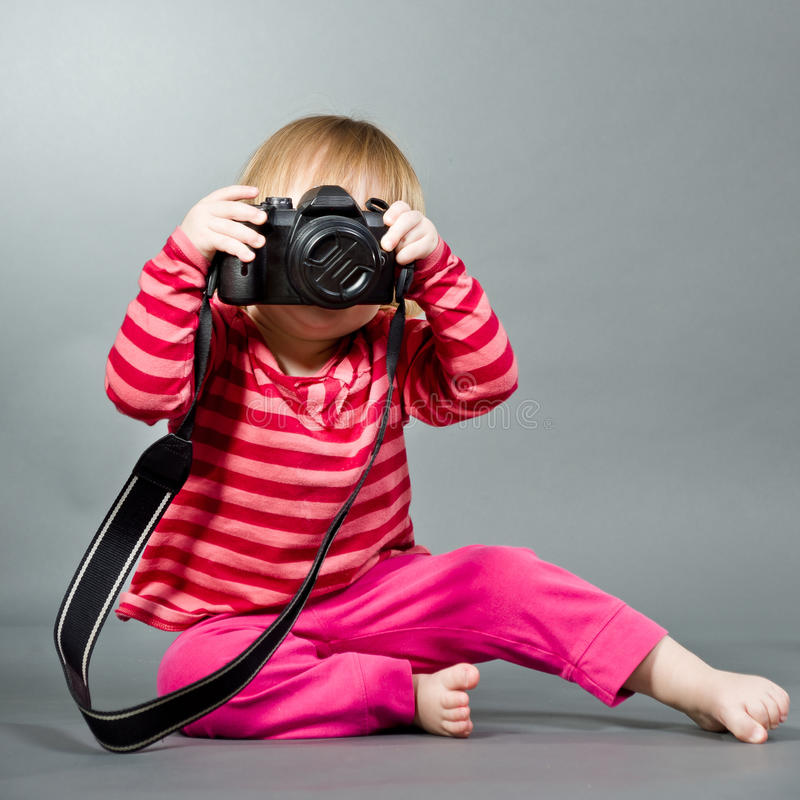 Cute little baby with digital photo camera stock image