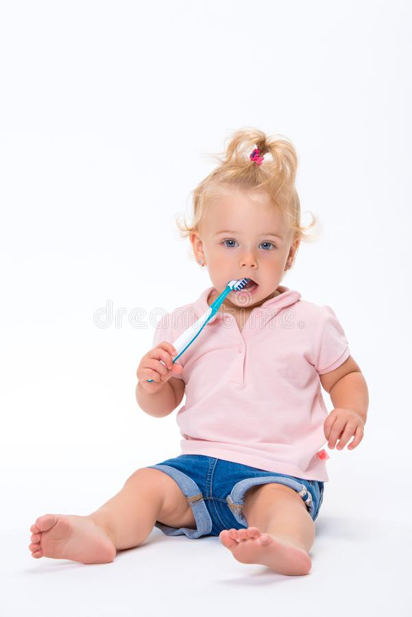 Free Cute Little Baby Girl 1 Year Old In Pink T-shirt Brushing Her Teeth Isolated On White Background Royalty Free Stock Photography - 139068497