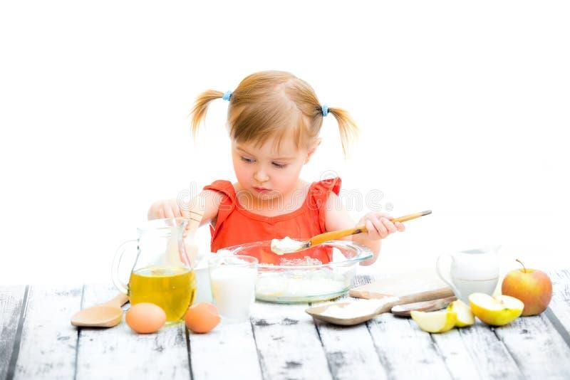 Cute little baby girl baking royalty free stock photos