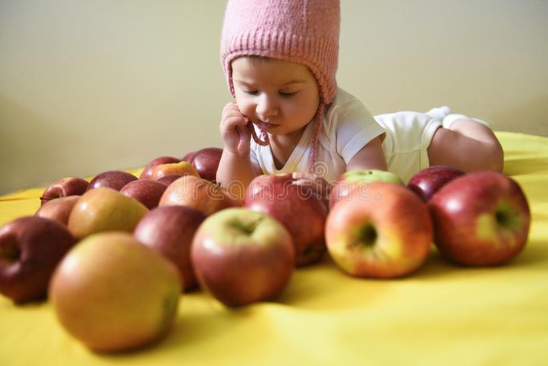 Baby girl and apples royalty free stock photo