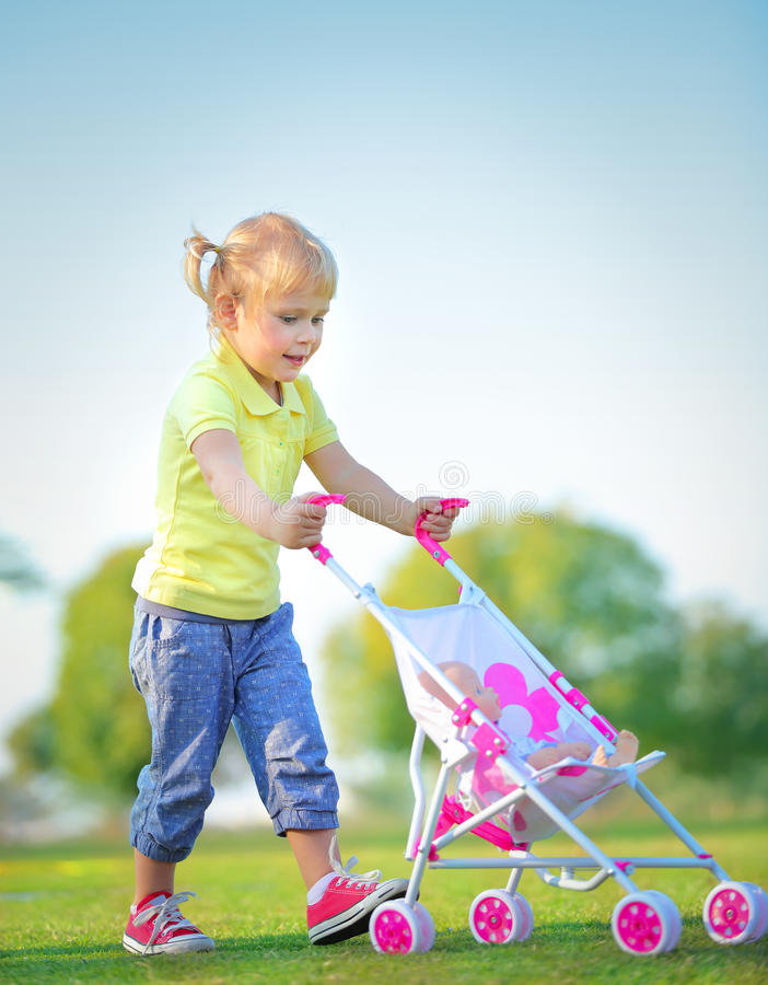 Cute little baby girl outdoors stock images
