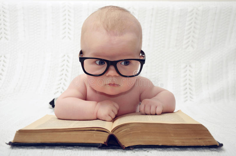 Cute little baby in glasses royalty free stock photo