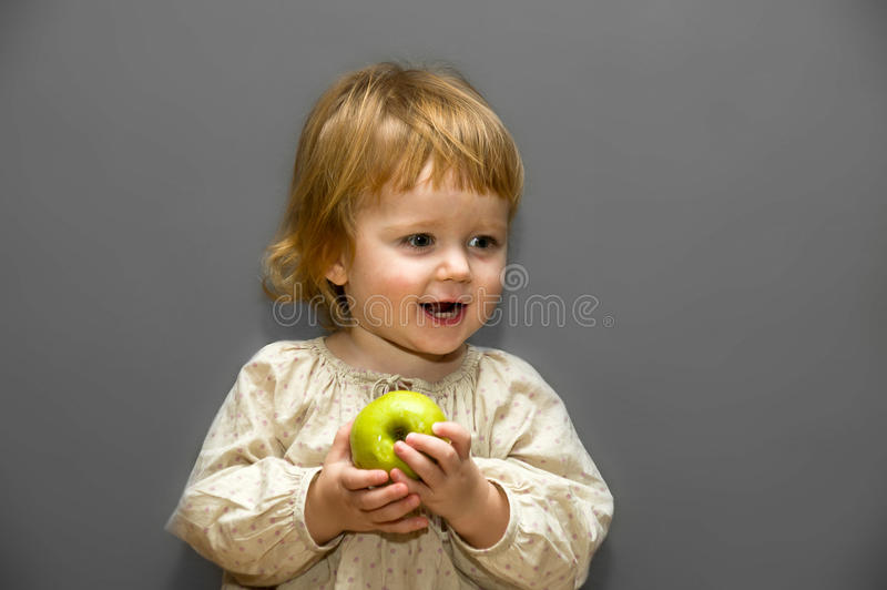 Download Cute Little Baby With Green Apple Royalty Free Stock Images - Image: 22720489