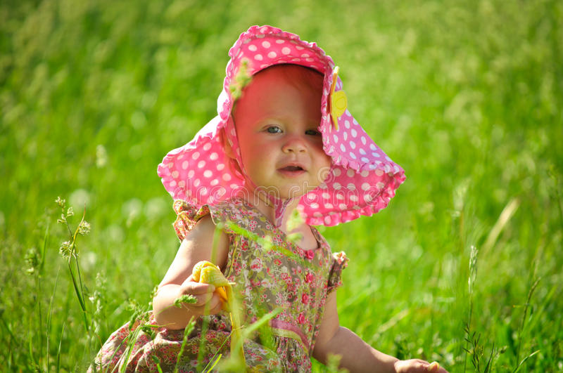 Download Cute Little Baby In Hat Sitting In The Grass Stock Image - Image: 20533537