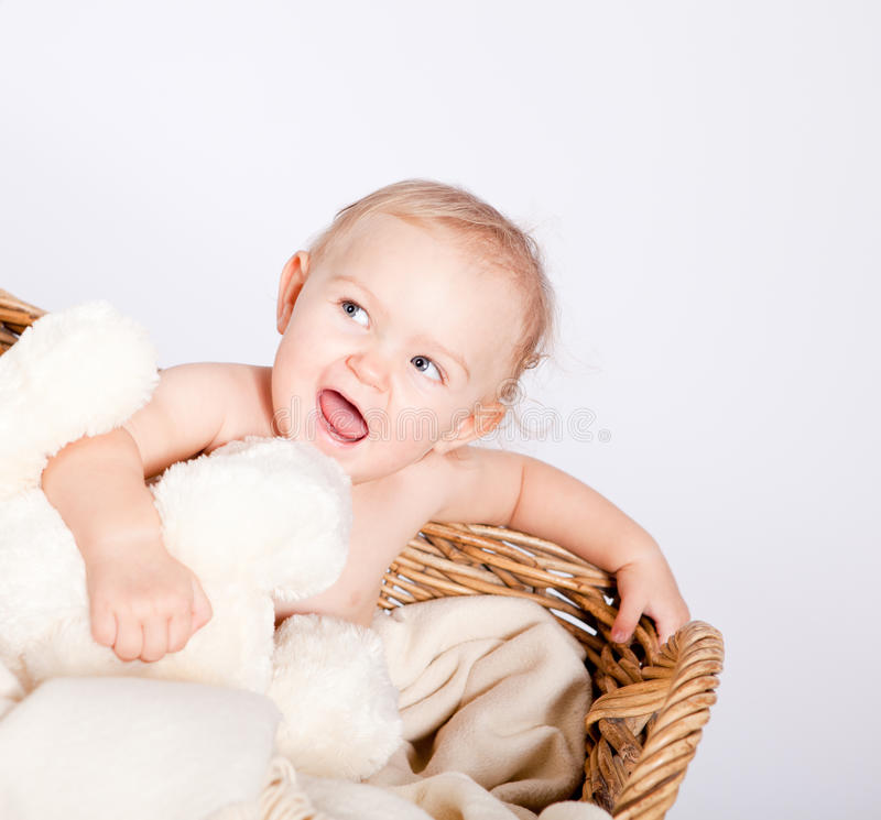 Download Cute Little Baby Infant In Basket With Teddy Stock Photo - Image of daughter, childhood: 27258286