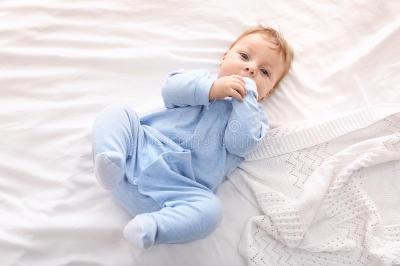 Cute little baby lying on bed, royalty free stock images