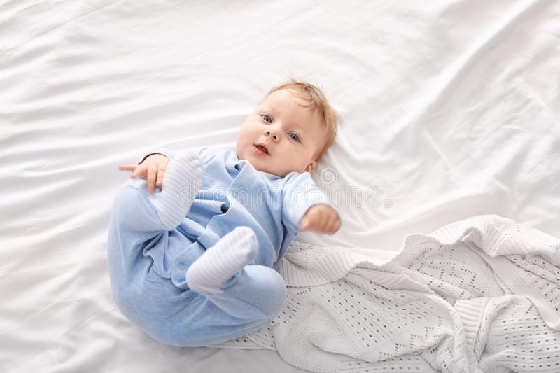 Cute little baby lying on bed, royalty free stock photo