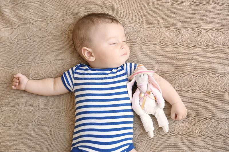Cute little baby sleeping. On bed stock photo