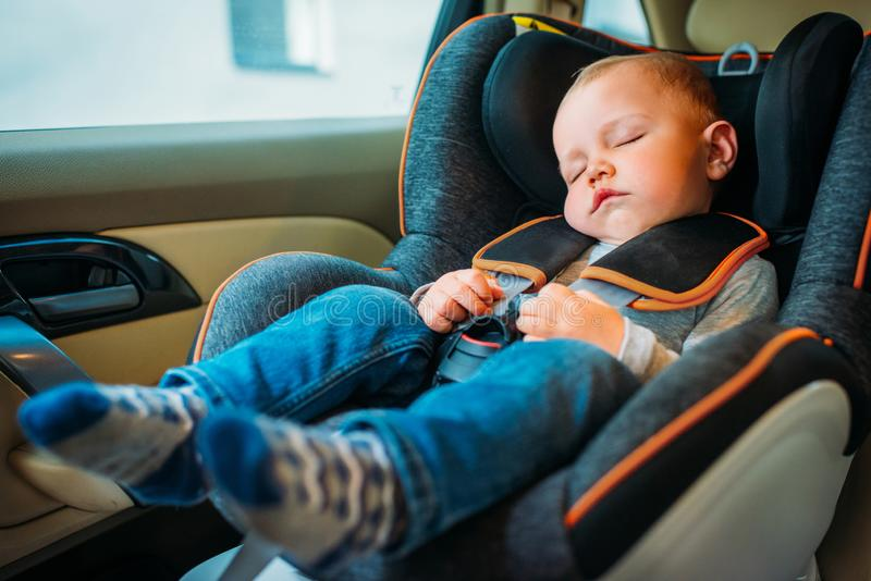 Cute little baby sleeping in child. Safety seat in car royalty free stock photos