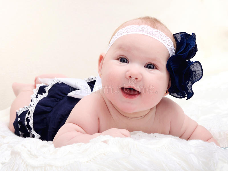 Cute little baby smiling royalty free stock images