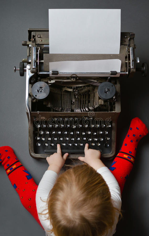 Cute little baby typing on typewriter. Cute little baby typing on retro typewriter stock image