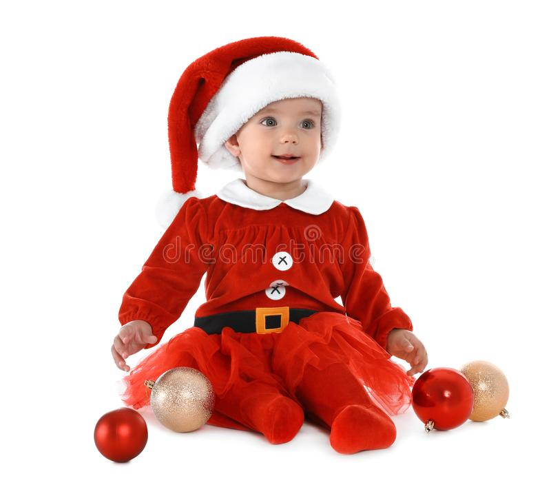 Cute little baby wearing festive Christmas costume on background stock photos