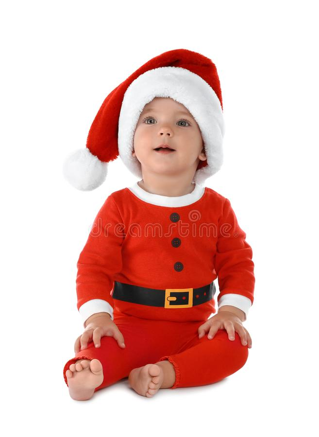 Cute little baby wearing festive Christmas costume on white stock image