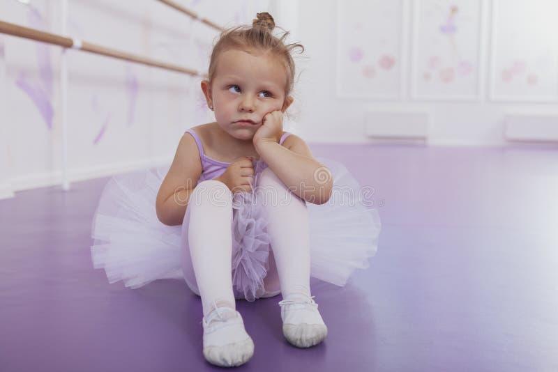 Cute little ballerina girl exercising at dance school royalty free stock photos