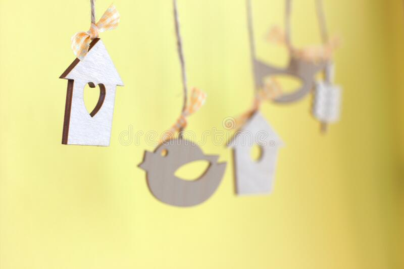 Cute little bird houses and wooden birds hanging, spring coming concept. Festive spring design royalty free stock photos