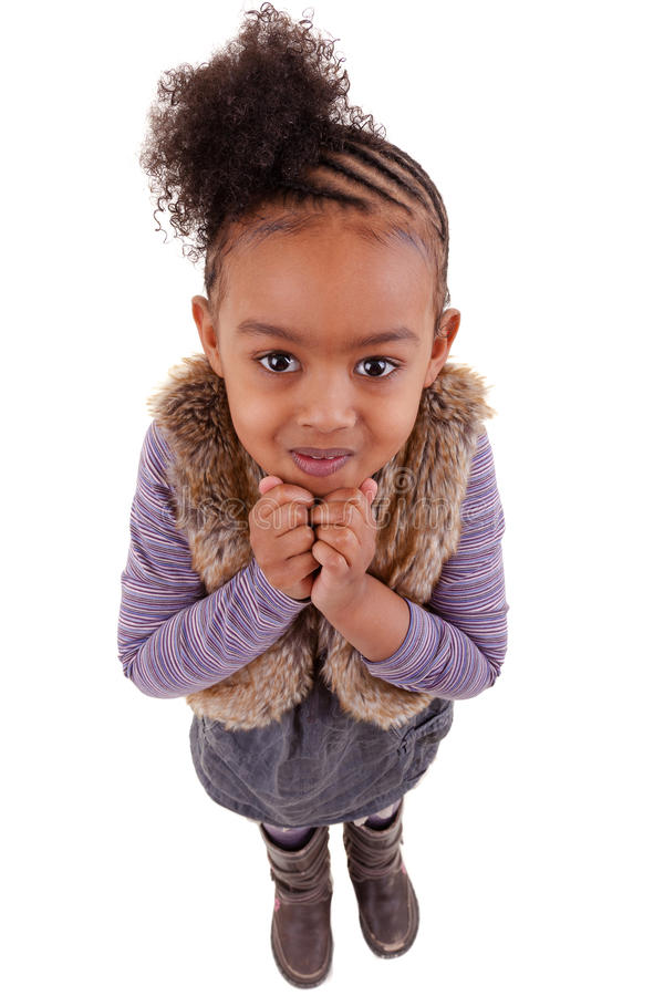 Cute little black girl looking up