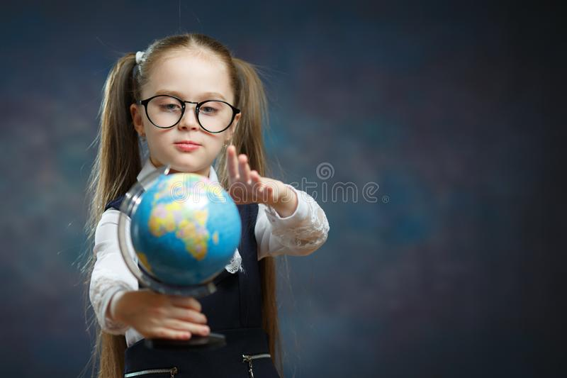 Cute Little Blond Schoolgirl Hold World Globe stock photo