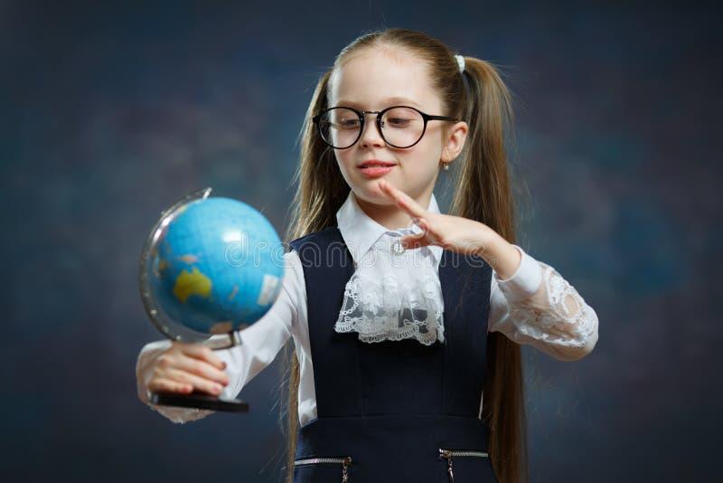 Cute Little Blond Schoolgirl Hold World Globe royalty free stock photo