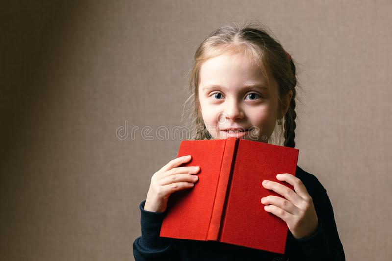 Cute little with book stock photos