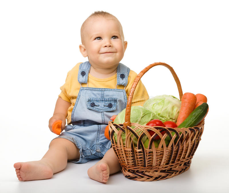 Download Cute Little Boy With Basket Full Of Vegetables Stock Photo - Image: 21079720
