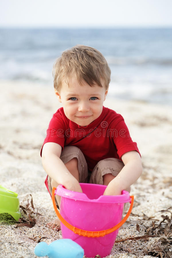 Cute little boy on the beach royalty free stock photo