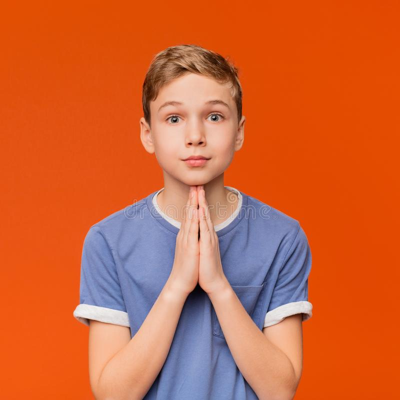 Cute little boy begging for his request royalty free stock image