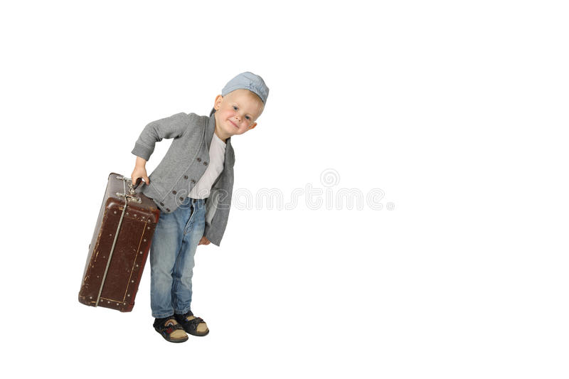 Cute little boy with big vintage suitcase in hand royalty free stock photos