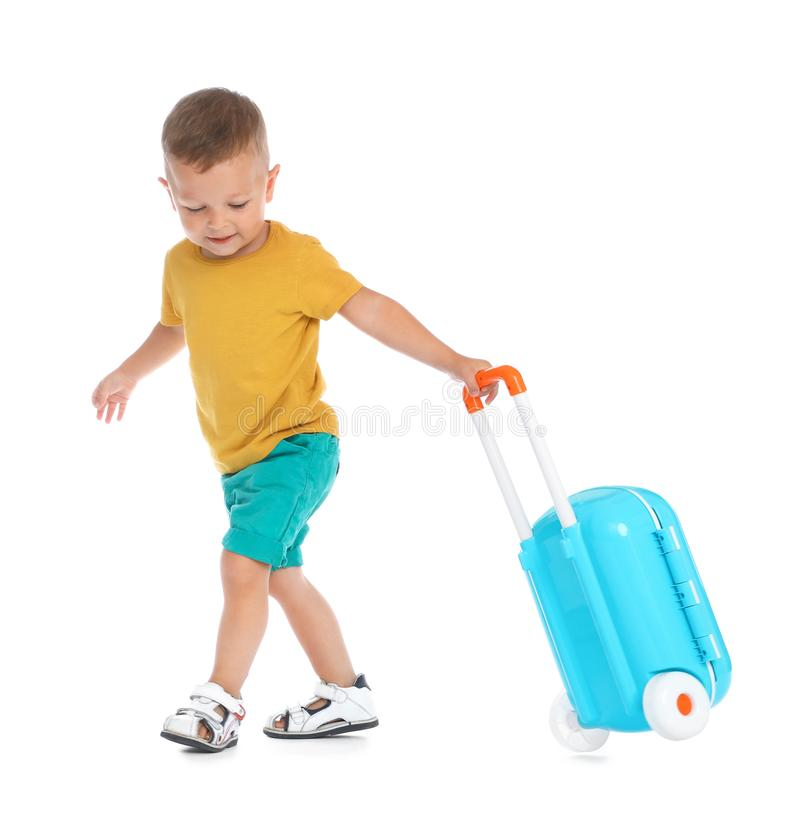 Cute little boy with blue suitcase on white stock photos