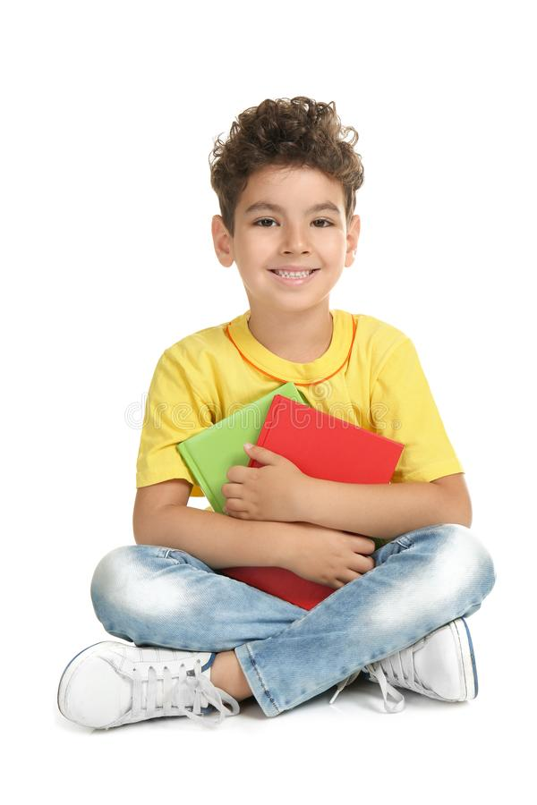 Cute little boy with books on white background royalty free stock photos